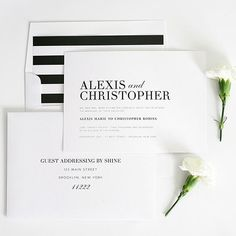Say it with stripes. Bold stripe-lined envelopes add interest to these glamorous black-and-white invitations. Complete the look with coordinating table numbers, thank you cards, and menus./