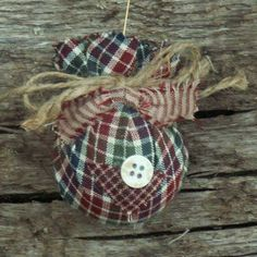 These primitive homespun Christmas ornaments are handmade from 100% cotton homespun fabric and embellished with assorted buttons, patches, and jute. No two of them ever turn out exactly the same....