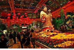 ASIAN VEGAS -- An 18-foot Chinese god of wealth and fortune is the centerpiece of Chinese New Year exhibit at the Bellagio's Conservatory and Botanical Gardens. The gardens include a koi pond, a pagoda and a 5-foot-tall rat made of alternanthera
