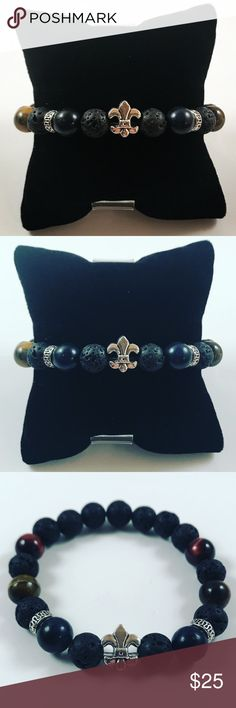 Men lava rock tiger eye fleur de lis bead bracelet Men beaded bracelet. Fits most , 7.5 to 8.5 inch wrist. Handmade by me , never worn by anyone. Made with black lava rock / volcano beads , red and golden tiger eye and onyx . Silver plated fleur de lis charm . I ship fast!!✈️Bundle and save !! ( 10 % off bundles) Any questions let me know ! No transactions outside Poshmark!! Accessories Jewelry