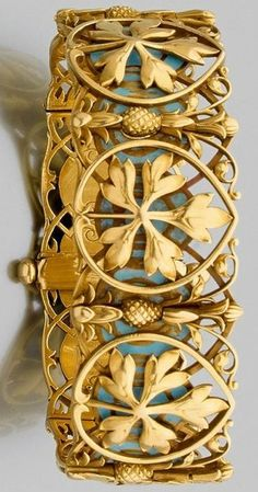 An enamel and gold bracelet by Alexis FALIZE circa 1880. The articulated 18 karat gold bracelet consists of seven rectangular openwork plane tree leaf plaques with pineapple links against a turquoise enamel background. With French assay mark, signed Alexis FALIZE. #Falize #ArtNouveau #bracelet