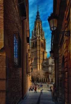 Toledo, Spain (I remember walking down this small street and suddenly seeing the cathedral looming over me)