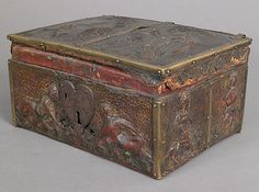 Coffret Date: 14th century Culture: French Medium: Embossed leather, walnut, gilding, polychromy, copper alloy and iron fittings Dimensions: Overall: 4 5/16 x 8 5/16 x 7in. (11 x 21.1 x 17.8cm) Classification: Leatherwork Credit Line: Gift of George Blumenthal, 1941 Accession Number: 41.100.194