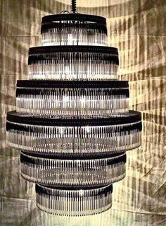 """Even ordinary ballpoint pens make for chandelier material. And thankfully so, as, unfortunately, many pens end up on landfills, where the polyethylene and polystyrene materials they are composed of decompose extremely slowly. Madrid-based design studio enPienza! created its six-tier """"Volivik"""" chandelier out of 895 Bic pens and paperclips. The light and patterns it creates is just incredible."""