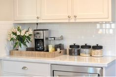 Lovely kitchen with pale gray walls, white shaker kitchen cabinets with carrara marble countertops and stainless steel appliances. Kitchen Pantry, Kitchen Dining, Kitchen Decor, Kitchen Cabinets, Organized Kitchen, Shaker Cabinets, Decorating Kitchen, Diy Kitchen, Kitchen Island