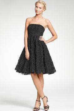 An ultra-flattering strapless dress featuring a full crinkle skirt for a play of textures and proportions. Grosgrain ribbon at waist accents the feminine silhouette. Hidden side zipper with hook-and-eye closure. Shelf bra with boning at bust. Fully lined. 25