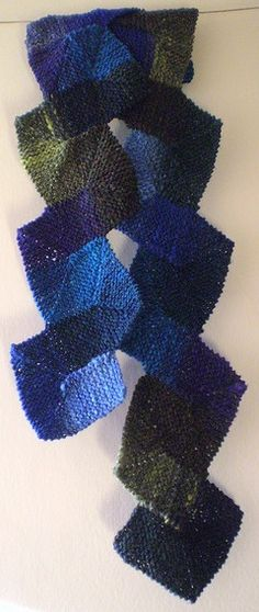 Ten Stitch Scarf-This pattern is available as a free Ravelry download. This garter stitch scarf is based on my Ten Stitch Blanket pattern and uses the same techniques of short rows and attached garter stitch but with a twist! It's fun to knit and there's no sewing up.