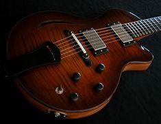 www.mykaguitars.com  Myka Guitars - Handcrafted Custom Guitars - Seattle, WA