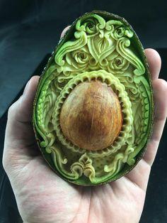 Carved ripe avocado