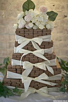 If a man really loved me, he would give me this Tim Tam engagement cake instead of a ring.
