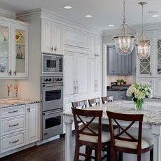 Love this look.  White x detail cabinets with grey counter and the microwave double oven combo