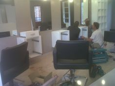 Having had the walls painted by Joao, Brotherwood team takes over with shop fitting...