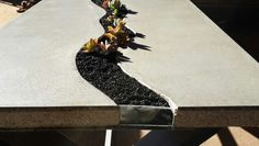 Concrete, steel and succulents in crushed slate