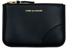 very stylish comme des garcons wallet, but the zipper style reminds me of my mom's coinpurse, hmmmm?