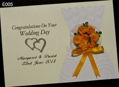 Congratulations On Your Wedding Day. Handmade cards with personalised. On a card of printed are the names of a married couple and the date of the wedding. Card finished with a beautiful orange roses made of satin ribbon. The main theme card is a dress of the bride. The perfect card for the wedding ceremony brides. http://www.handmadecards24.co.uk/product/wedding_dress_card