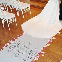 The Timeless Personalized Aisle Runner is the perfect, polished pathway to walk down on your wedding day! The beautiful runner showcases the marrying couple's names surrounded by an elegant scrolling border. Choose from 17 different accent colors to match your wedding color scheme.