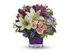 Teleflora's Garden Romance - Va-Va-Bloom! Grand array of purple hydrangea, light pink spray roses and white asiatic lilies is presented in a modern violet cube.