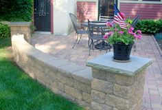 A freestanding wall helps to separate a patio from the rest of the yard and can also be used as a seat!