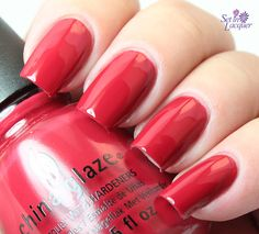Tip Your Hat is a classic red crème polish.