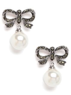 Channel the feminine allure of the Belle Epoque with these sweet drop earrings. They feature glistening pearls and an oh-so-charming set of crystal-embellished bows.