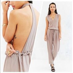 Taupe Textured Drawstring Jumpsuit Very sexy conservative jump suit in a taupe color. Worn only for a couple of hours. It's literally in new condition. Love it but never wore it again and it's just been sitting in my closet. Urban Outfitters Pants Jumpsuits & Rompers