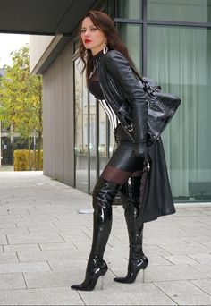 Long leather coat over short leather skirt and magnificent boots and long…