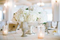 #hydrangeas, #candles, #silver  Event + Floral Design: Kim Fisher Designs - kimfisherdesigns.com Photography: Scott Piner Photography - scottpiner.com/  Read More: http://stylemepretty.com/2011/08/11/bald-head-island-wedding-by-scott-piner-photography/