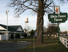 """White Fence Farm dates to the 1920s and serves the """"World's Greatest Chicken"""" family style. While you wait you can play with and observe a large collection of antique machines, cars, and other artifacts in a rambling building that feels like it dates to the 1920s."""