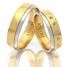 Perechea de verighete ATCOM141 este confectionata din aur de 14k in nuante de aur galben si aur alb.