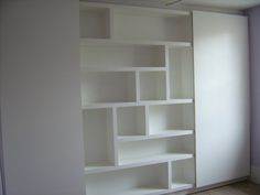 idea for the built in wardrobe for spare room, you could get blake to create a bookshelf/cubbys in the middle part where the mirror was especially if this is going to be your office?