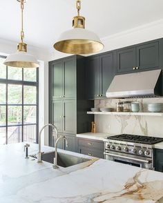 Kitchen Decor kitchen-with-marble-countertop-pendant-lights-green-blue-cabinets-elizabeth-roberts - When a young family—a lawyer and dance professor and their two young sons—purchased a Brooklyn townhouse, the building had been subdivided into four apartm Classic Kitchen, Kitchen Modern, Stylish Kitchen, Modern Kitchen Fixtures, Urban Kitchen, Timeless Kitchen, Home Modern, Modern Light Fixtures, Sweet Home