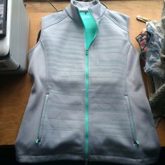 Nike Golf Fleece Vest Nike Golf gray vest with aqua fleece lining the inside, zipper up the front and zipper pockets. NWOT. Size: Medium. Nike Jackets & Coats Vests