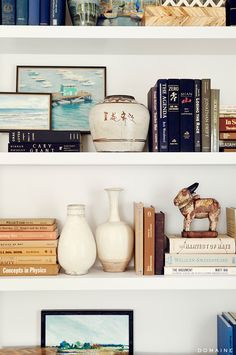 Bookshelves styled with artwork and trinkets