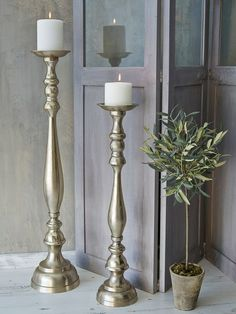 There's no grander statement than these magnificent floor-standing candlesticks, which have an aged, textured finish and heaps of heirloom style.