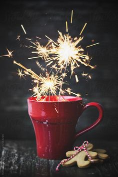 Red mug with sparklers and gingerbread men by RuthBlack | Stocksy United