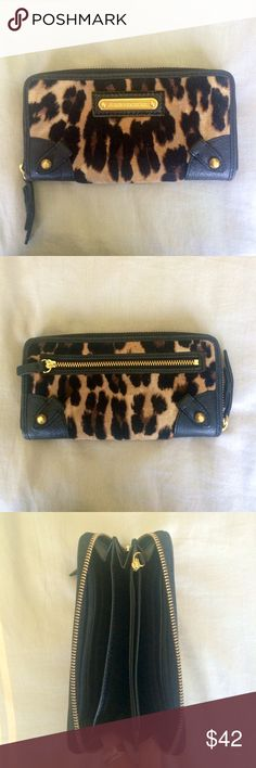 Juicy Couture animal print wallet EXCELLENT COND Leopard print wallet - Juicy Couture. Zips close and inside has credit card holder and separate compartments along with a zippered coin purse inside as well as a zippered compartment on the back. EXCELLENT CONDITION!! Thank you for looking!! Juicy Couture Bags Wallets