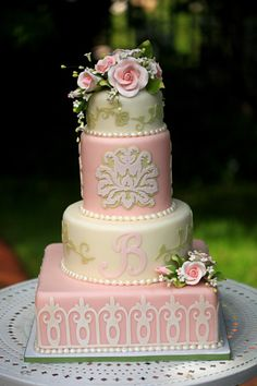The pale pink and green keep this wedding cake from being too traditional for my taste.