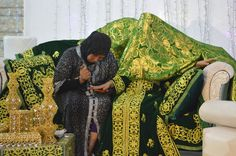 At the Moroccan wedding. A lady paints the hands of the bride (Morocco, berber) by henna. --Your Shot. NATIONAL GEOGRAPHIC.