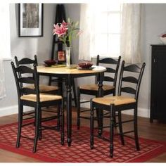 *****@Overstock - This five-piece round dining room set is ideal for family meals in your eat-in kitchen as well as in your dining room. The contrast between its natural-colored top and chair pads and its sturdy black rubberwood frame accents your present decor.http://www.overstock.com/Home-Garden/Round-Counter-Height-5-piece-Dining-Set/5723648/product.html?CID=214117 $409.99