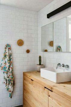 Muuto dots, subway tiles, wooden vanity See more Tile Trendsfor 2014: http://www.pinterest.com/citytile/tile-trends-2014/