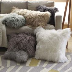 Adorable Mongolian lambskin pillow covers for sofa throw pillows, from West Elm, to echo the lambskin rug's warm texture. They look like little animals!
