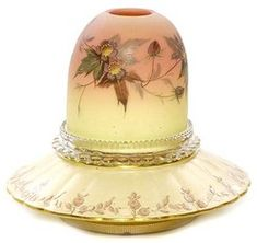 lighting, England, A Webb Burmese three-part fairy lamp, dome shade in Prunus pattern, clear holder marked S Clarke English pottery base having gold highlights pink flower. Circa 1885-1925
