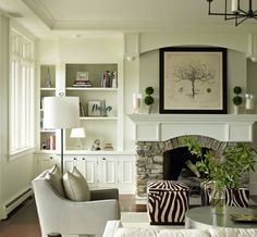 I think stone fireplaces look really great and cottage-like with a chunky white mantle. And the white bookshelves flanking are so classic and lovely.