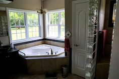 Master bathroom with sunken Jacuzzi tub in corner.