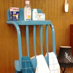An old chair with vertical back slats can be repurposed into a quaint towel rack and shelf, like this one recently for sale on Etsy from the Rusty Bucket. Custom-order one from the Rusty Bucket or make your own by removing the chair legs, shortening the seat into a shelf, and hanging it upside down.   - Redbook.com