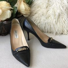 """Jimmy Choo black leather heels Authentic⚜ Jimmy Choo black leather heels with champagne colored metal detail at toe. Luxurious and sophisticated. Leather wrapped 3.5"""" heel. Gently loved with only some minor wear.  States size 38 fits size 7.5 best Jimmy Choo Shoes Heels"""