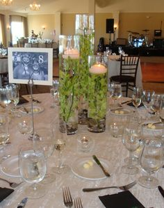 Budget friendly tall rented vases with green dendrobium orchids.