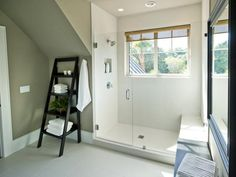 In stark contrast to the colorful bedrooms: Crisp white porcelain tile and dark walnut-stained furnishings define this spa-like bathroom space. http://www.hgtv.com/dream-home/hgtv-dream-home-2013-guest-suite-bathroom-pictures/pictures/page-3.html?soc=dhpp