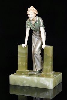 Ferdinand PREISS - The Stile - A bronze and ivory figure of a standing woman leaning forward with each hand resting on a green onyx square section pillar, all to a rectangular onyx base, height 25cm. Reference Art Deco and Other Figures Bryan Catley p. 260. (hva)