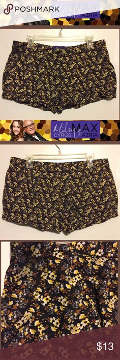 "MILEY CYRUS MAX AZRIA Yellow/Black Flower Shorts SIZE 15. 10.5"" Length. 34"" Waist. 2"" Inseam. Honey Yellow, Black, Brown & White Colors. Miniature Flowers Design. 100% Cotton. 2 Front Pockets. Short Shorts. Machine Wash. Perfect Condition. Miley Cyrus Max Azria Shorts"
